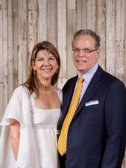 Gage and Mark LeQuire were among the Tocqueville Society