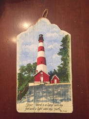 """Assateague Light"" is a painting by Jean Mason. Mason"