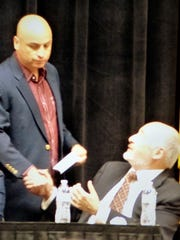 New Mexico Attorney Gen. Hector Balderas shakes hands with Ruidoso Mayor Tom Battin at the sheriffs association opening session.