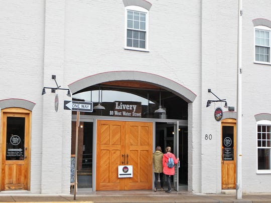 The Water Street Livery, a former livestock auction house in downtown Harrisonburg in the late 1800s, was taken on as a renovation project by Matchbox Realty CEO Barry Kelley and Chathill & Associates owner Andrew Forward and now houses the wood-fired pizza restaurant, Bella Luna.
