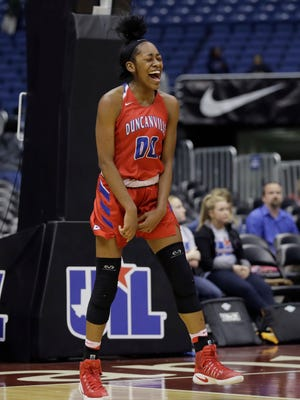Duncanville's Zarielle Green celebrates the team's win over Houston Cypress Ranch in the UIL girls' Class 6A state basketball final, Saturday, March 4, 2017, in San Antonio. Duncanville won 76-65.