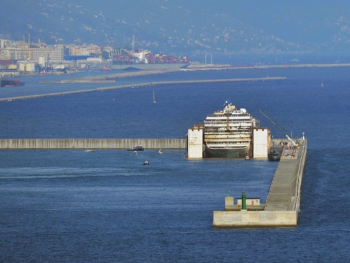 The Italian cruise liner Costa Concordia sits in a dock inside of Voltri Port in Genoa. The Costa Concordia's dismantling operations are predicted to last two years.