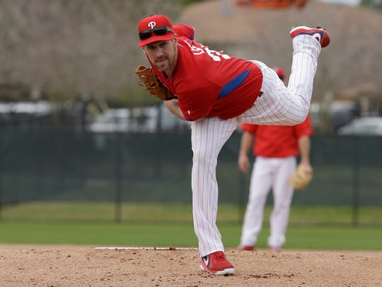 Phillies starting pitcher Cliff Lee follows through on a pitch during a spring training workout in Clearwater, Fla. Lee is trying to pitch for Philadelphia despite an injury that could eventually require season-ending surgery.