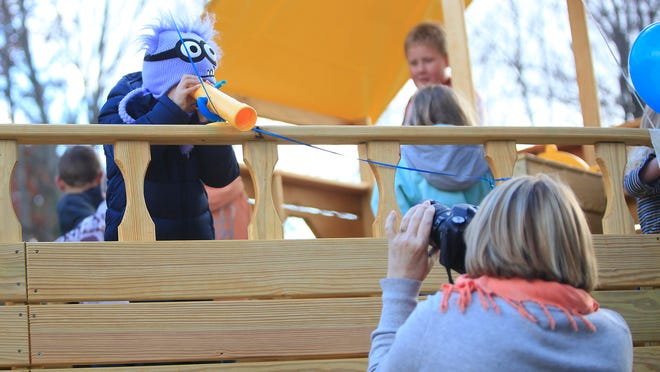 Eli Mullinix, an energetic 5-year-old who suffers from Acute Lymphoblastic Leukemia, poses for photographs Friday afternoon for family and friends as he celebrates his new pirate-themed playhouse from the Make-a-Wish Foundation.