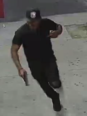 Authorities allege this man, seen running from the scene of a fatal shooting on May 10, is 37-year-old Shomari Kinard of Camden.