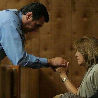 Manuel Avila holds hands with his wife, Carmen Avila,