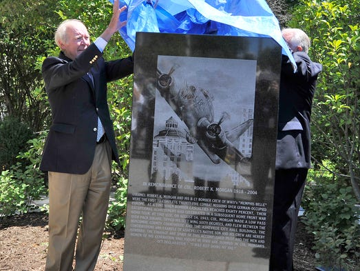 Dedication of the monument honoring Col. Robert Morgan, pilot of the World War II bomber Memphis Belle. Morgan flew the bomber between the county and city buildings during a war bonds tour.