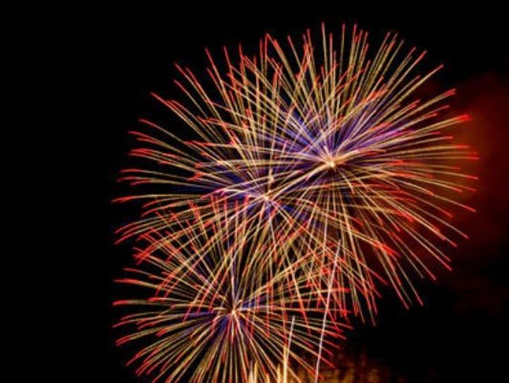 Fireworks burst over the night sky