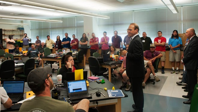 Dr. Vince Bertram speaks during an interactive training that focuses on engineering and computer science. The hands-on approach allows the educators to better prepare for implementing Project Lead The Way curriculum in their classrooms this fall.