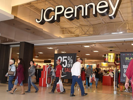 Black Friday shoppers come and go from the JCPenney