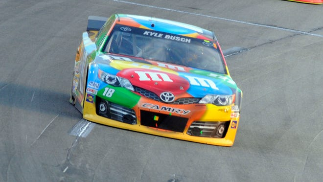 Kyle Busch (18) finished second at the Quaker State 400 Saturday night at Kentucky Speedway.