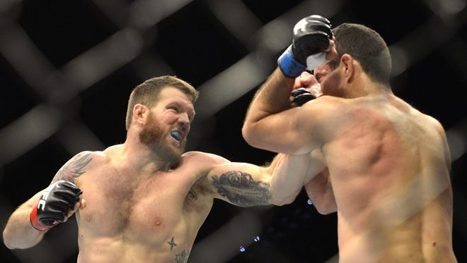 Ryan Bader (left) strikes Anthony Perosh during their Dec. 7, 2013 UFC bout. It was the first of five straight wins for Bader.