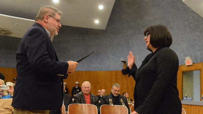 Mayor Christopher Vergano pictured  swearing in Lonni Miller Ryan earlier this year after she was re-elected council president.