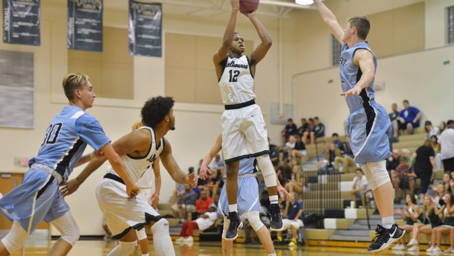 Keon Smith shoots for Melbourne High during the first half against Hagerty.