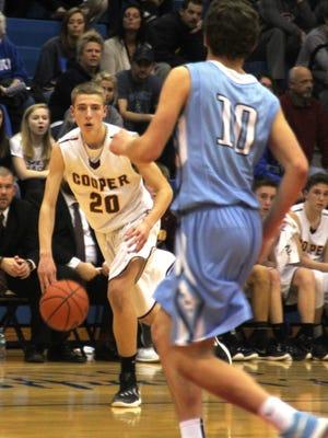 Cooper freshman Blaine Walters surveys the defense. 33rd Boys District semifinals: Cooper defeats Boone County. Boys basketball. Feb. 24, 2016. Conner HS. Hebron KY.