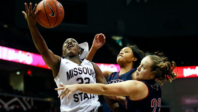 Missouri State Bears guard Tyonna Snow (22) attempts a layup as she is guarded by Pioneers defender during fourth quarter action of the Lady Bears game against MidAmerica Nazarene University at JQH Arena in Springfield, Mo. on Nov. 17, 2015.