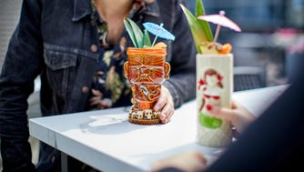 The Conrad Chicago's new rooftop bar, Noyane, serves its Painkiller cocktails (Mount Gay Black Barrel Rum, pineapple orange, coconut, nutmeg) in tiki mugs.