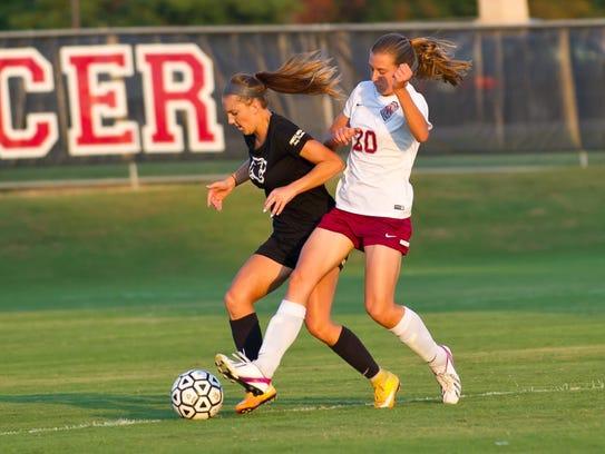 Powell's Brooke Huffaker, left, gains possession during