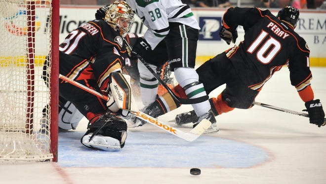 Anaheim Ducks right wing Corey Perry (10) helps goalie Frederik Andersen (31) defend the goal against Dallas Stars center Vernon Fiddler (38) during the second period at Honda Center.