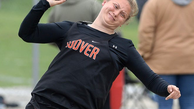 North Canton Hoover's Kelsey Kinsley throws to win the shot put at the 2019 Stark County Championships.