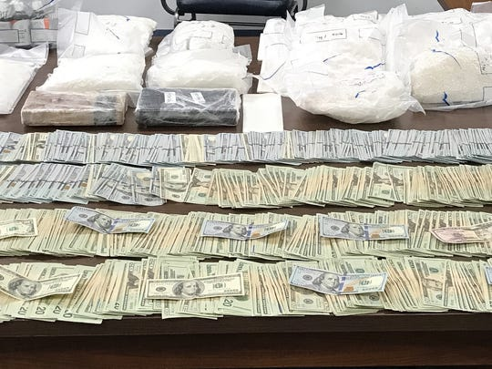 Police arrested Derrick Felton after search warrants resulted in the seizure of nearly 2 million dollars in cash and illegal narcotics.