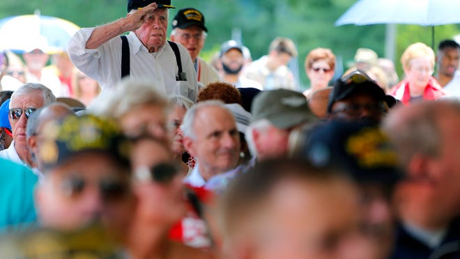 May 30, 2016 - A Merchant Marine stands at attention while his service song plays during the Memorial Day ceremony at the West Tennessee State Veterans Cemetery.