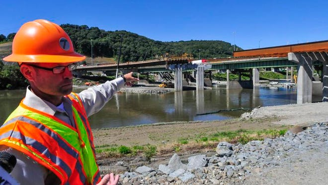 Jack Williams, regional director for the New York State Department of Transportation, talks about the construction work over the Chenango River on Sept. 6, 2013.