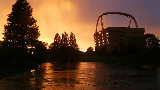 The sun sets behind the Longaberger headquarters in Newark.