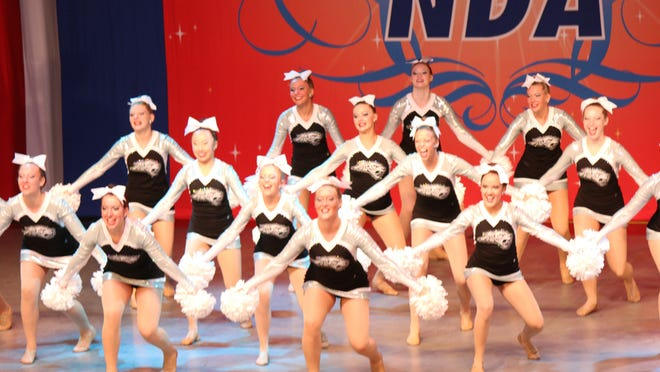 The Ankeny Centennial High School dance team performs its pom routine at the National Dance Alliance National Championship in Orlando, Fla., earlier this month.