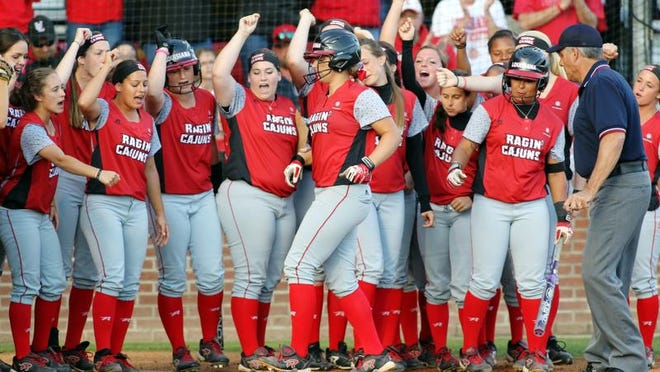 UL players greet Lexie Elkins at home plate after her two-run home run in the first inning against McNeese State during Wednesday's 5-4 win at Lamson Park.