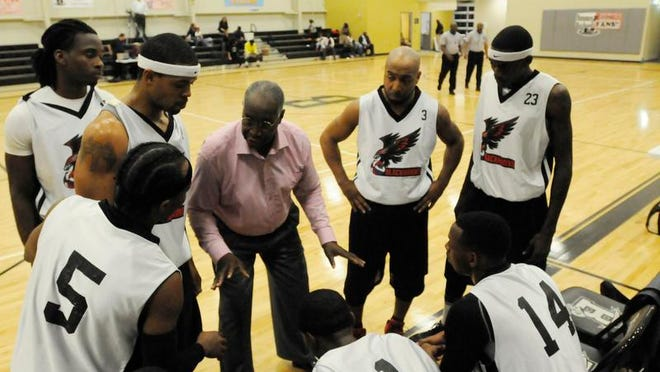 Coach Bob Heard and the Blackhawks lost to the Heat 131-123 in overtime.