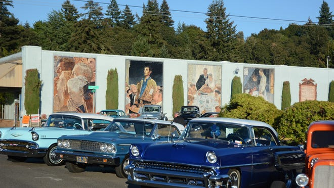 Norman Rockwell's Four Freedoms loom over classic cars during First Friday in downtown Silverton on Sept. 5, 2014.
