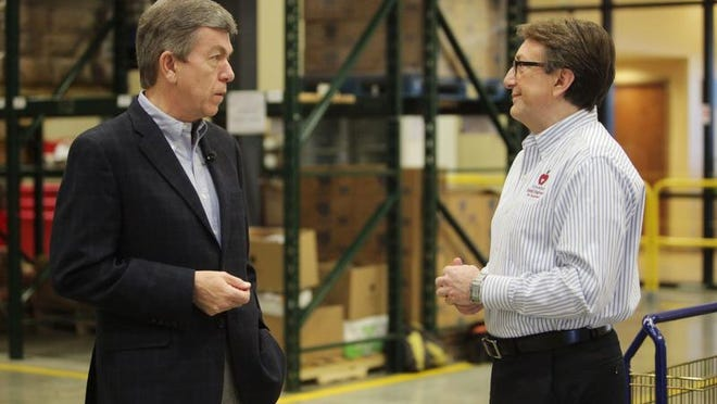 U.S. Sen. Roy Blunt talks with Ozarks Food Harvest CEO Bart Brown at Ozarks Food Harvest on Monday. Smart Chicken donated nearly 10,000 pounds of chicken to the food bank.