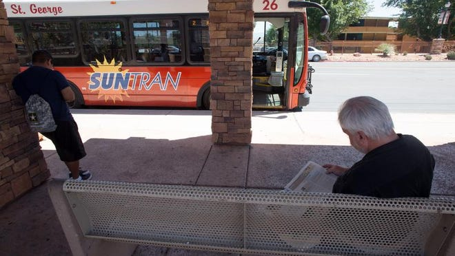 Suntran passengers wait for connecting busses to arrive at the main St. George terminal Monday, June 17, 2013.