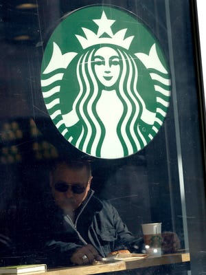 A Starbucks customer sits inside a store on Jan. 22, 2015, in San Francisco.