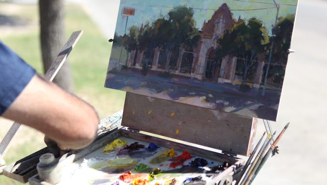 Danny Griego of San Diego, CA paints the scenery Barbed Wire & Roses Oct. 25, 2016. He is one of several artists participating in En Plein Air Texas.