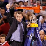 Associate Head Coach Steve Wojciechowski of the Duke Blue Devils celebrates after he cut down a piece of the net following their 61-59 win against the Butler Bulldogs during the 2010 NCAA Division I Men's Basketball National Championship on April 5, 2010 in Indianapolis, Indiana.