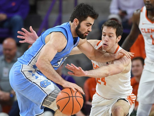 Clemson forward David Skara (24) guards North Carolina