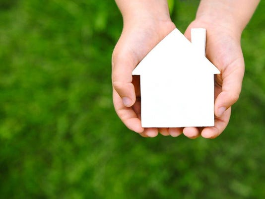 Thinkstock house in hands