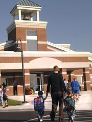 Students and parents walk into Mountain Bay Elementary