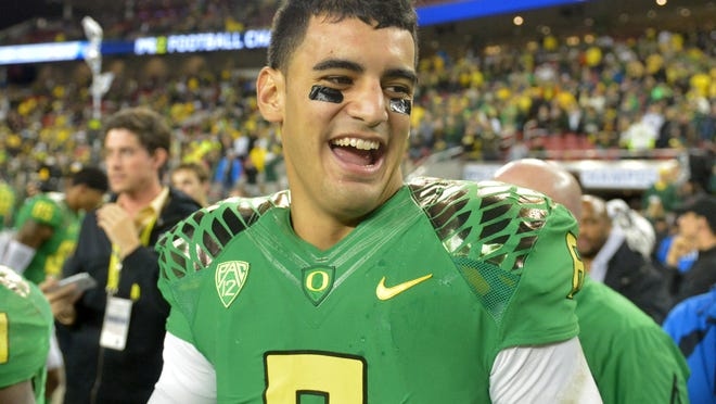 Marcus Mariota and the Oregon Ducks have had a lot to smile about this season, including beating Arizona on Dec. 5 for the Pac-12 Championship.
