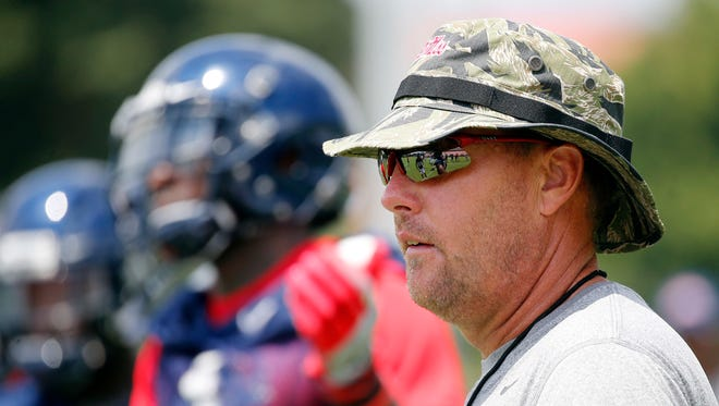 Coach Hugh Freeze watches his players practice during preseason camp. Ole Miss opens the season on Sept. 5 against Florida State.