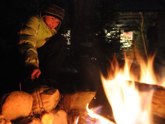 Mya Ploor roasts marshmallows over the open fire. Chestnuts were also offered during Natural Christmas.