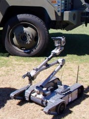 An iRobot 501 Packbot can be carried using one hand.