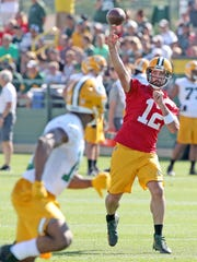 Aaron Rodgers throws during last year's Packers training
