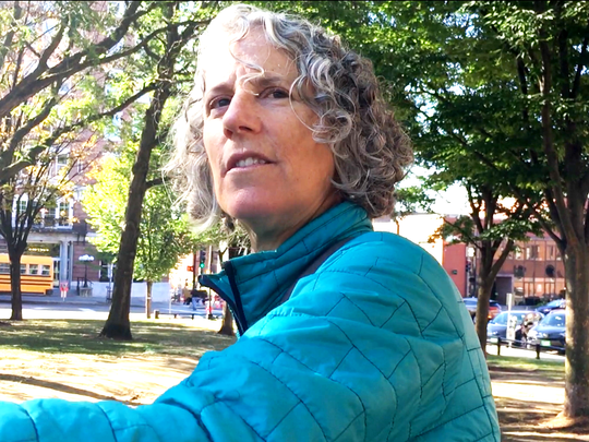 Julie Campoli, a Burlington-based urban designer, on Monday weighs the features of City Hall Park. Photographed Oct. 2, 2017.