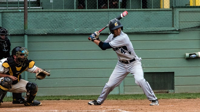 Vince Gonzalez, shown at bat, is among the Corban baseball players who will visit Cuba.