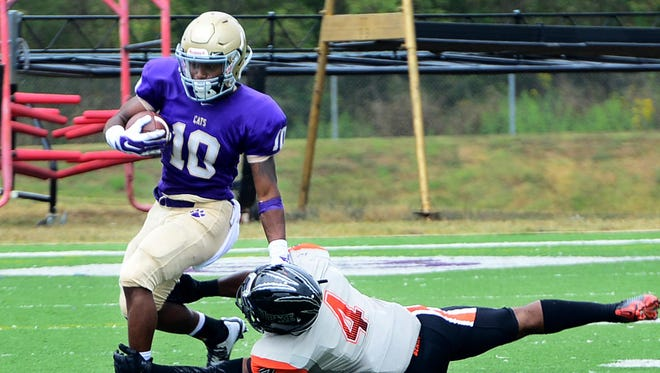 Bethel University's Quincy Walden attempts to outrun Pikeville's Dario Bennett during their game Saturday afternoon.
