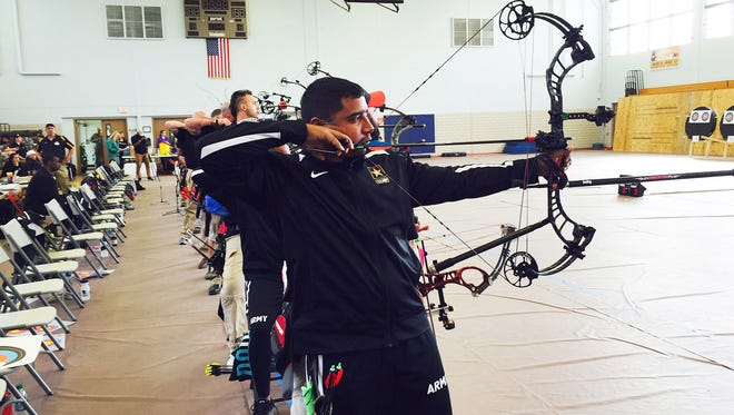 Sgt. 1st Class Julio Rodriguez, representing Fort Gordon, Ga., participates in archery at the Army Trials last week at Fort Bliss.