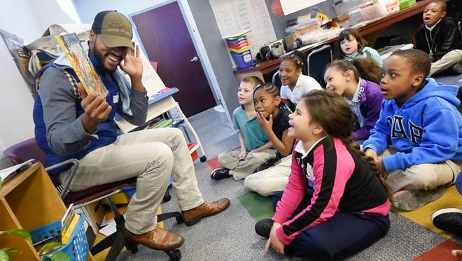 Jarrett Kinard, of York, reads to a second-grade class at Jackson Elementary during the 2016 100 Men Reading event.